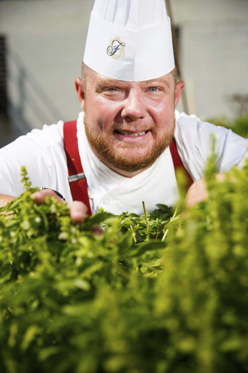 MIKE DEAL / WINNIPEG FREE PRESS</p><p>Tim Palmer, executive chef at the Fairmont Winnipeg, at the rooftop herb garden. </p>