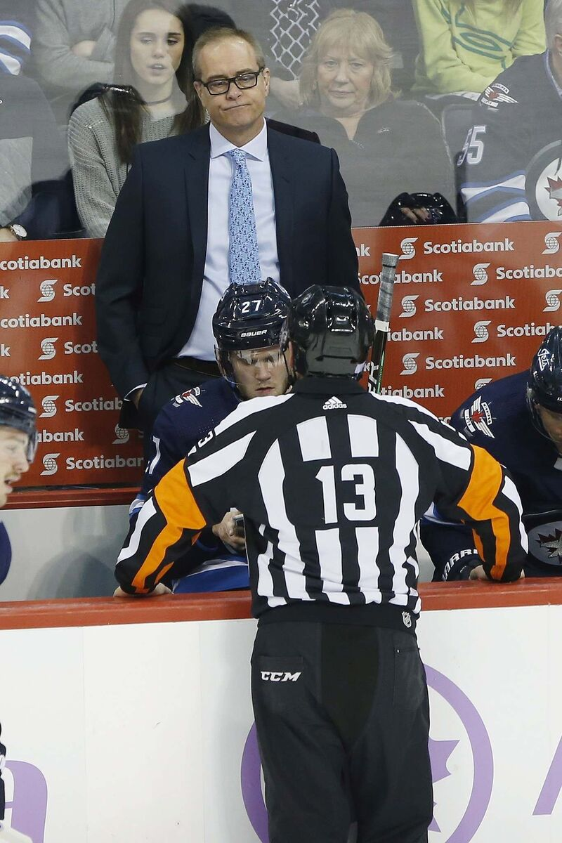Winnipeg Jets head coach Paul Maurice talks to a referee during the first period NHL action against Chicago Blackhawks in Winnipeg. (John Woods / The Canadian Press)