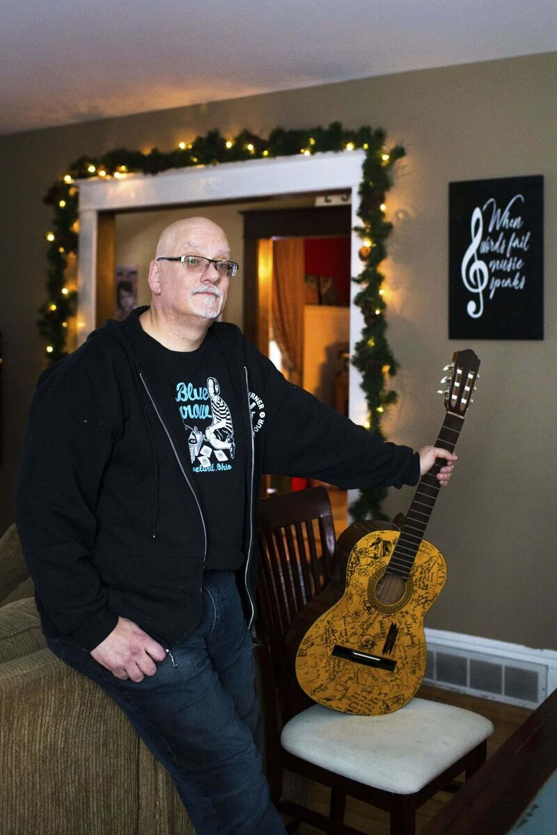 Dozens of acts who have played there have signed his guitar. (Mikaela MacKenzie / Winnipeg Free Press)