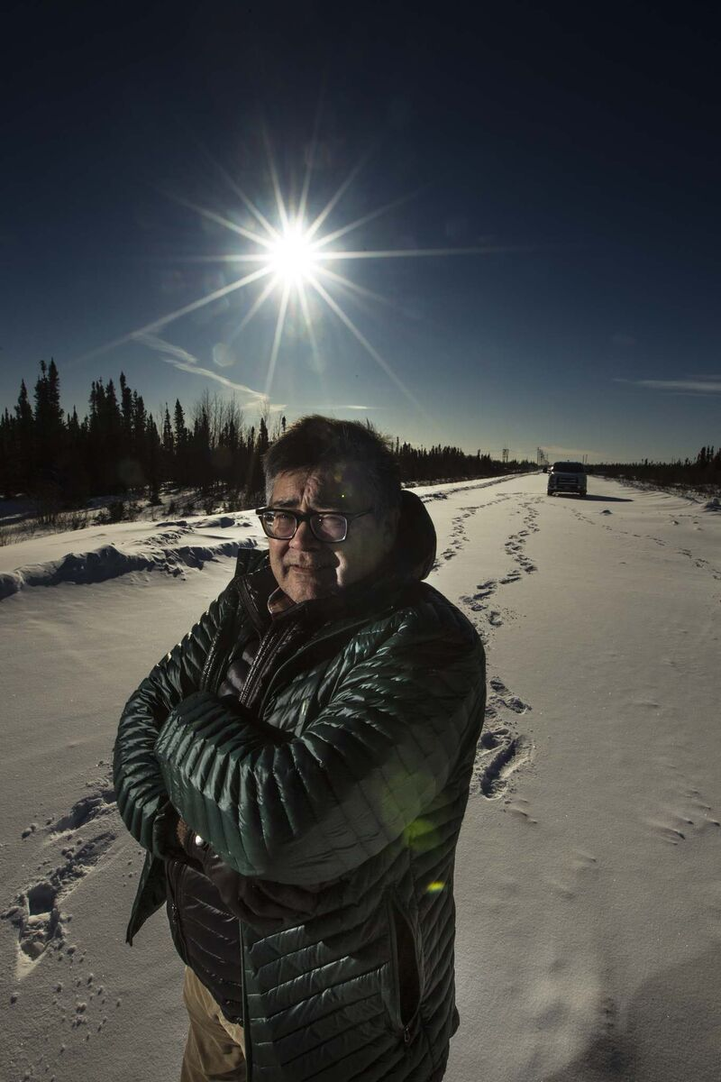 PHIL HOSSACK / WINNIPEG FREE PRESS</p><p>Michael Lawrenchuk poses on the dead-end strip of Highway 290, the farthest point north that is drivable in Manitoba.</p>