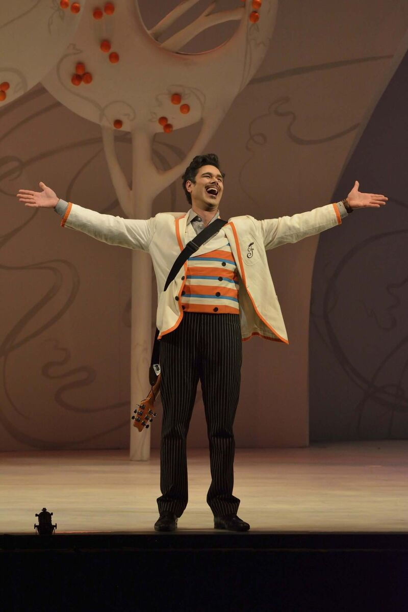 Elliot Madore plays Figaro in The Barber of Seville, Rossini's delightfully silly opera. Madore's booming baritone voice is a show-stopper.  (Robert Tinker photo)