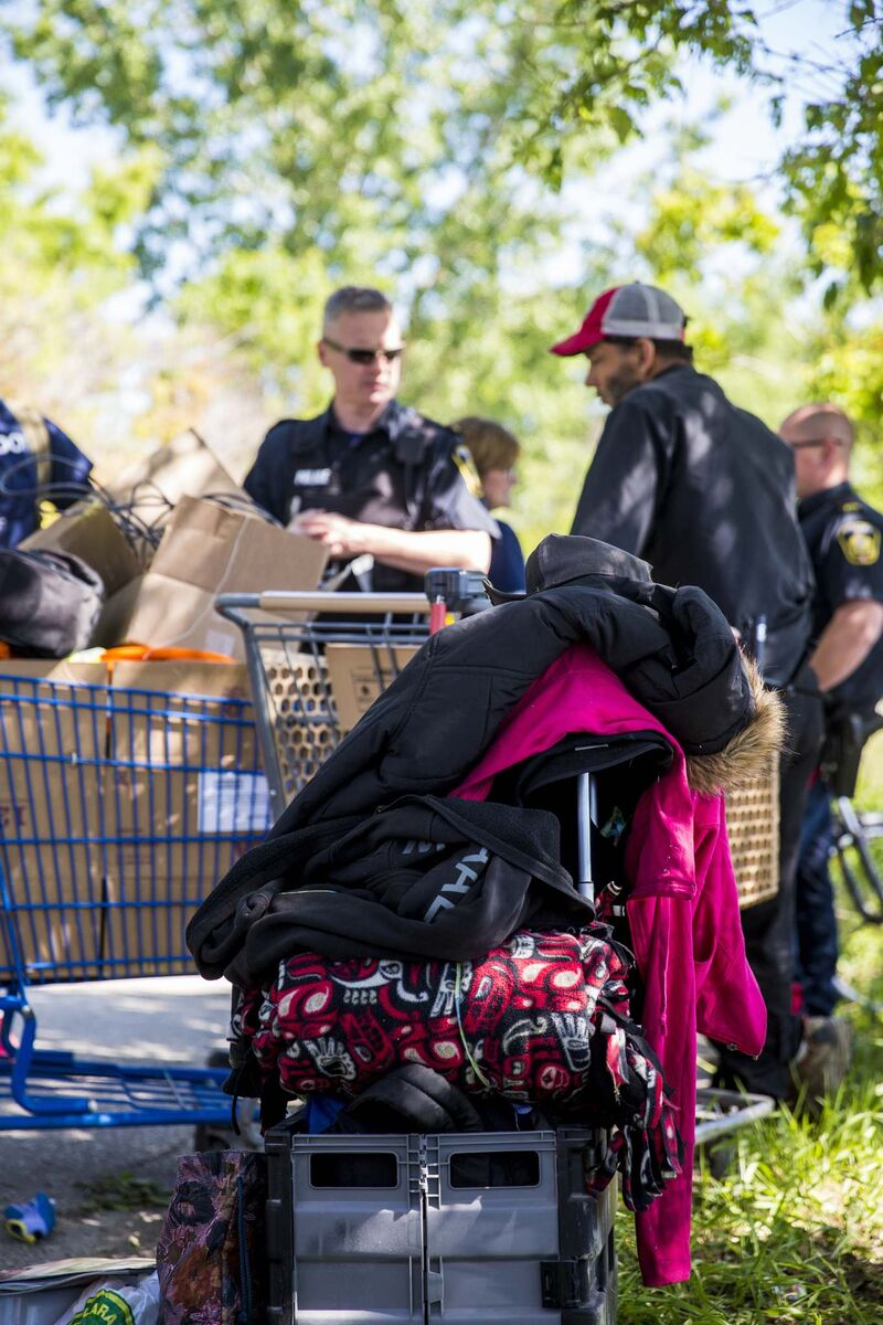 Winnipeg police confront Rebecca and Jeff with their belongings in St. Boniface.</p>
