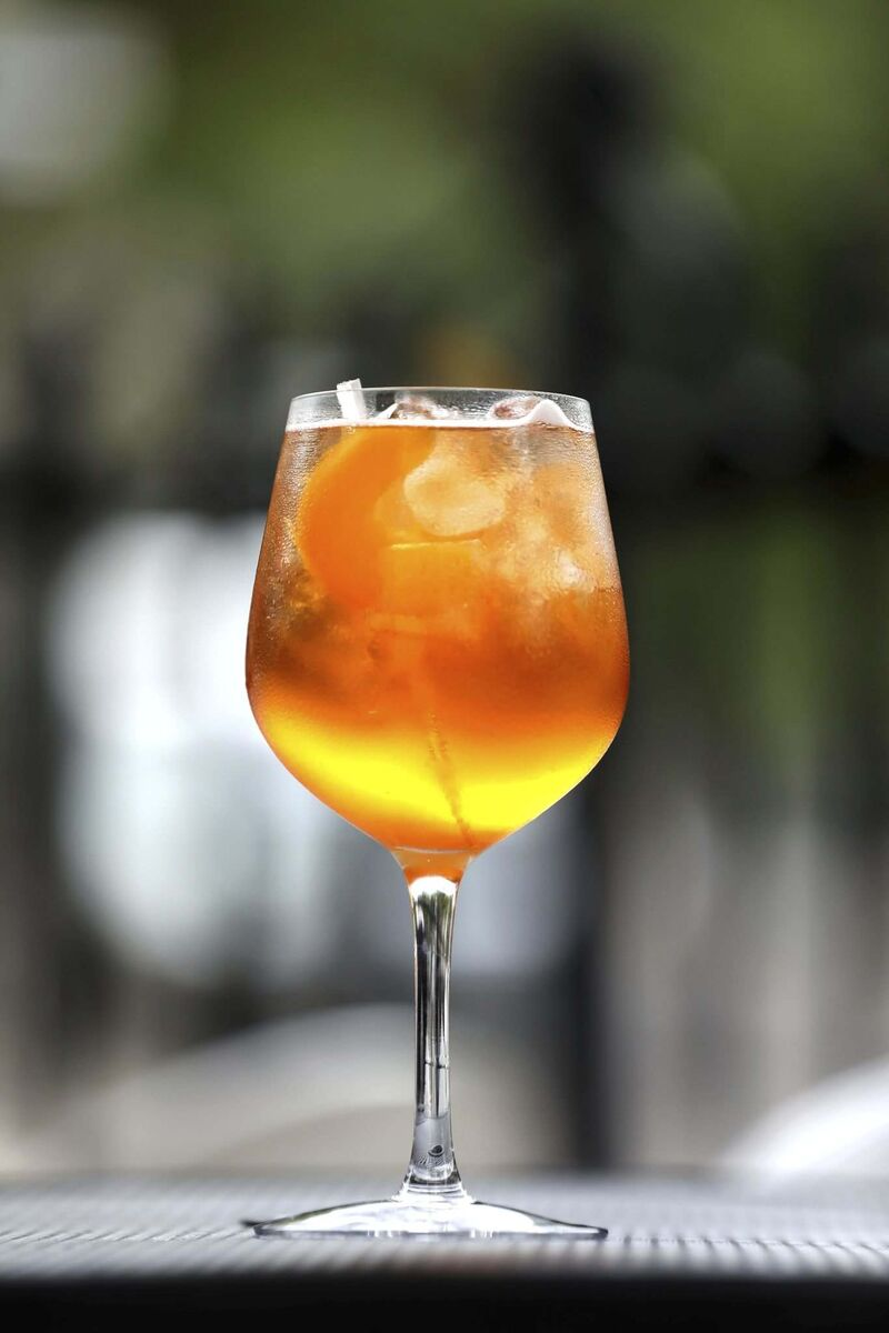 The Beet and Peaches includes three kinds of alcohol: bourbon, Aperol and prosecco.  (Ruth Bonneville / Winnipeg Free Press)