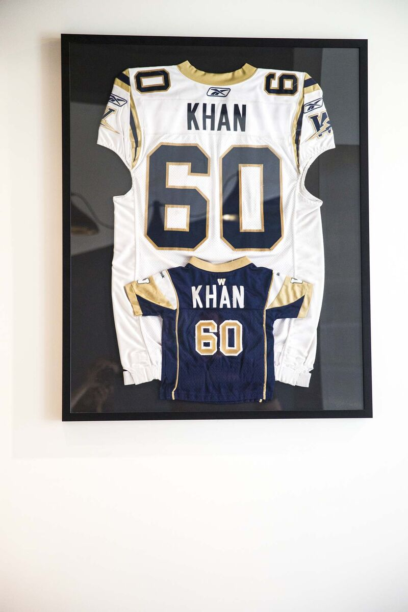 MIKAELA MACKENZIE / WINNIPEG FREE PRESS</p><p>Khan's jersey hangs with his son's at the Shawarma Khan location on Graham Avenue.</p>
