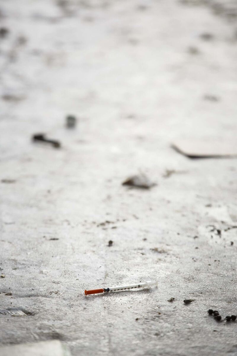 The area around Victoria Court is a frequent dumping ground for used needles. (Mike Deal / Winnipeg Free Press)