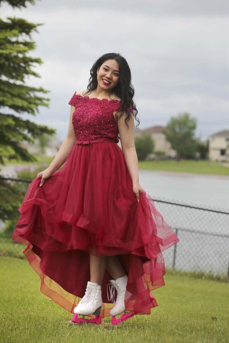 Vanessa Navarro, who danced and did figure skating throughout her formative years, poses in her grad dress with her skates in the family's yard. (Ruth Bonneville / Winnipeg Free Press)