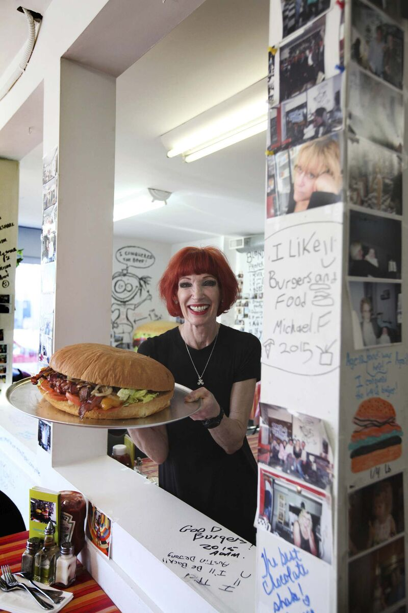 Blondie's Burgers owner Sandy Doyle shows off a nine-pound burger, one of the Main Street restaurant's signatures.</p></p>