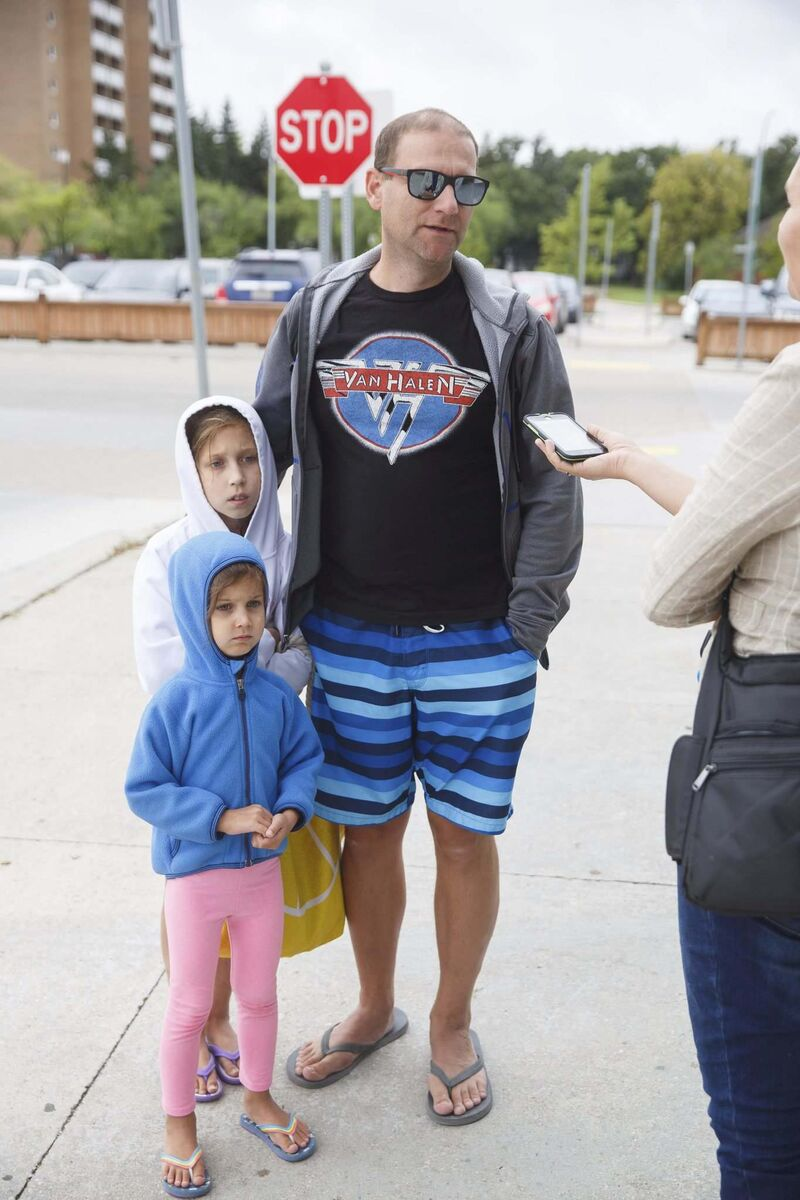 Chris Buffie and his children, Elena, 9, and Gabriella, 5, arrive at Pan Am Pool for their swimming lessons Friday morning.