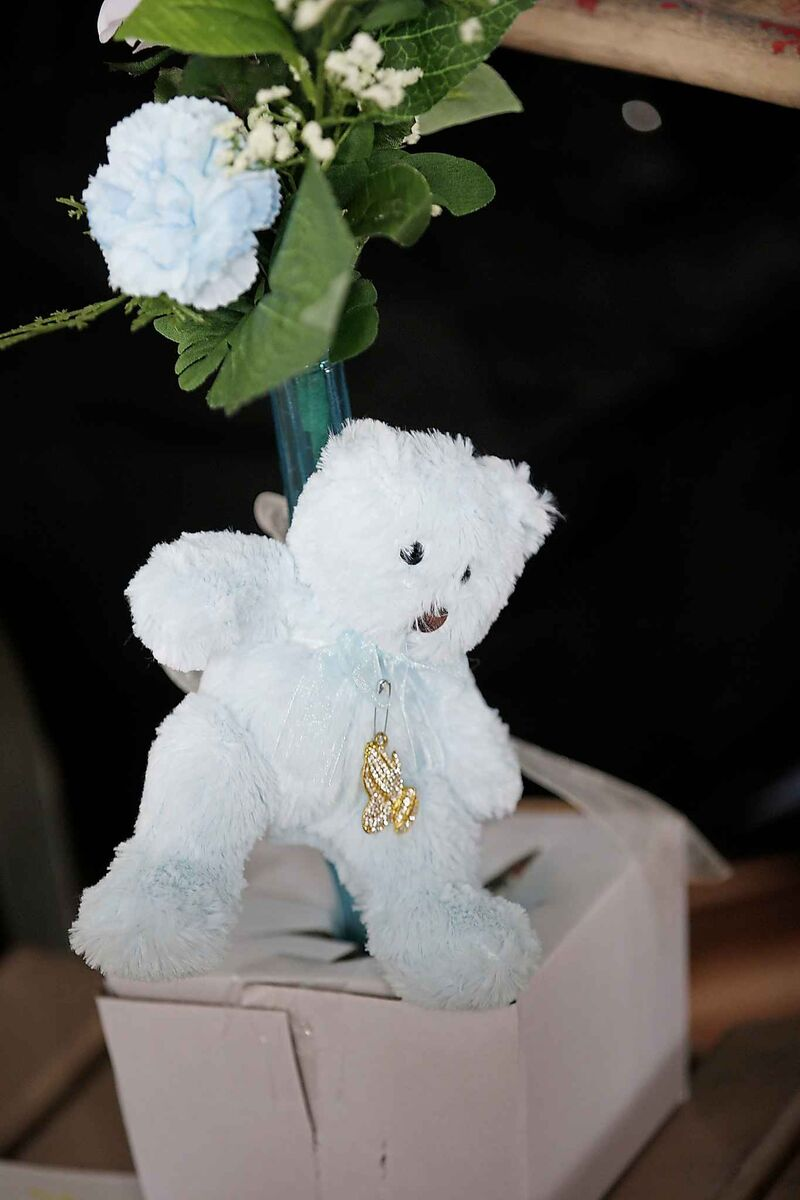 A toy bear is left by mourners at the vigil.