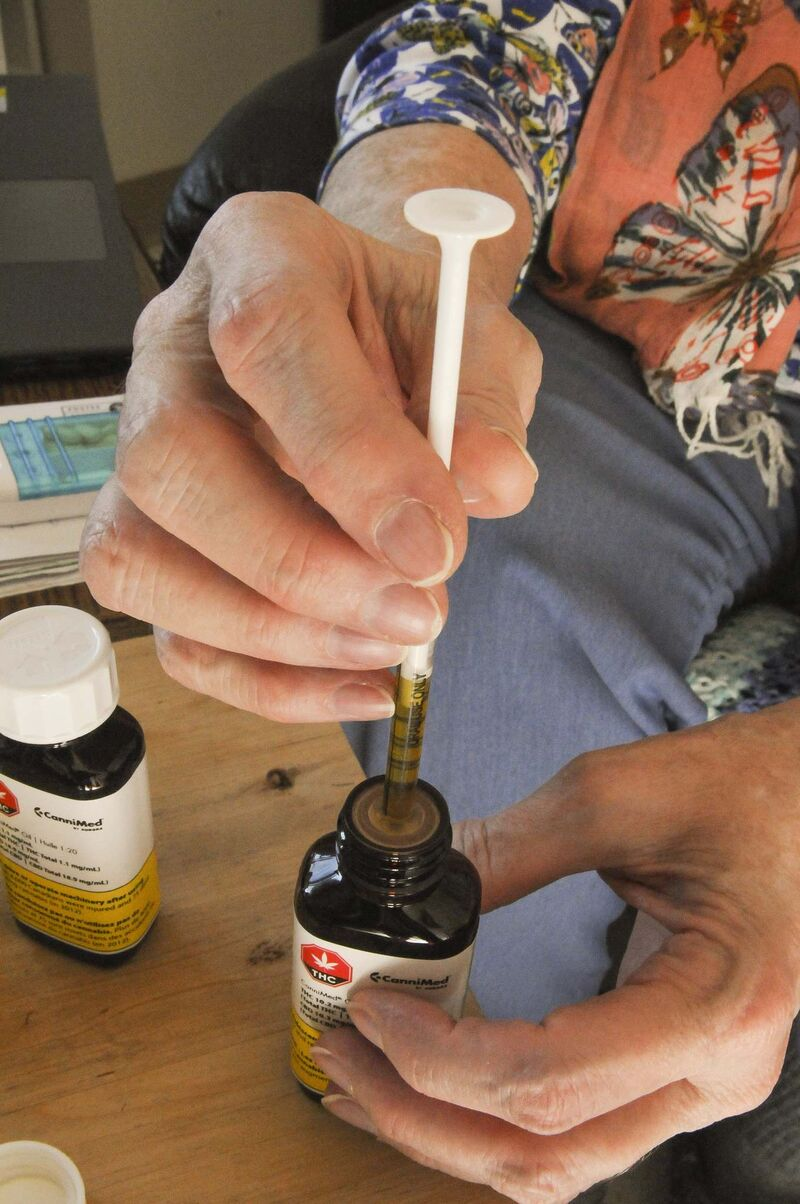 Sandi Krasowski / Winnipeg Free Press</p><p>McMillan uses a syringe to extract cannabis oil.</p>
