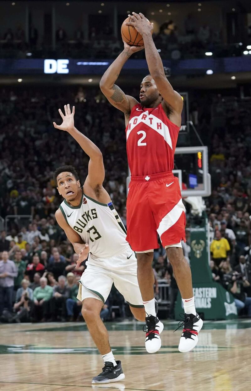 The Toronto Raptors' Kawhi Leonard (right) has been the best player in the playoffs. (Morry Gash / The Associated Press files)