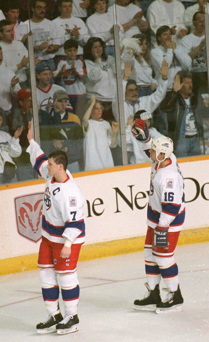 Capitan Keith Tkachuck, left, and teammate Eddie Olczyk wave goodbye to the fans after losing the series to the Detroit Red Wings