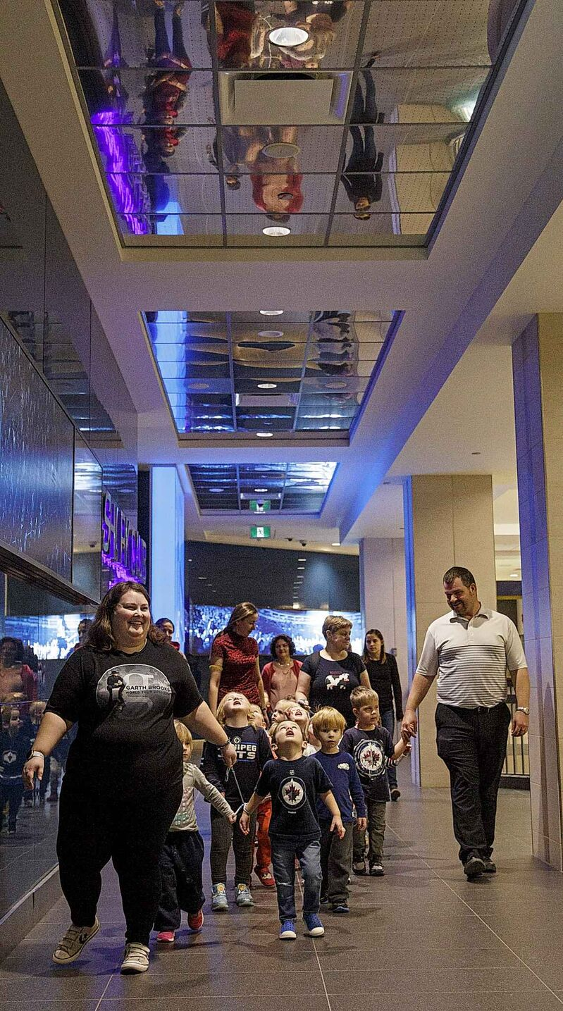 "The kids shout ""Hi! Hi! Hi!,"" as they walk underneath the mirrored ceiling in CityPlace. (Mike Deal / Winnipeg Free Press)"