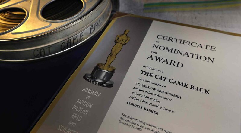 Cordell Barker's certificate of nomination for the Academy Awards and a film reel of The Cat Came Back.   (Wayne Glowacki / Winnipeg Free Press)