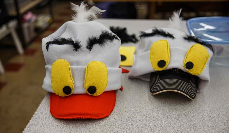 Sewing students work on making head gear for costumes for Scuttle and Gull (Mike Deal / Winnipeg Free Press)