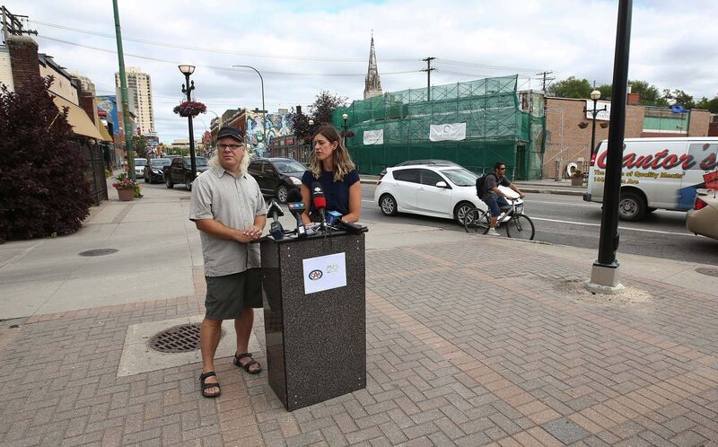 Liz Kulyk (right) with CAA Manitoba and Mark Cohoe with Bike Winnipeg hope a new poll will help frame the discussion about infrastructure and cycling ahead of the civic election. (Mike Deal / Winnipeg Free Press)</p>