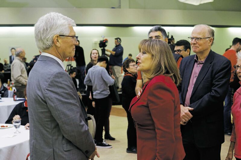 LIberal MP Jim Carr (left) accepts election-night congratulations from Gail Asper after being re-elected in Winnipeg South Centre on Oct. 21, while Manitoba LIberal MLA Jon Gerrard looks on. (Danielle Da Silva / The Canadian Press files)