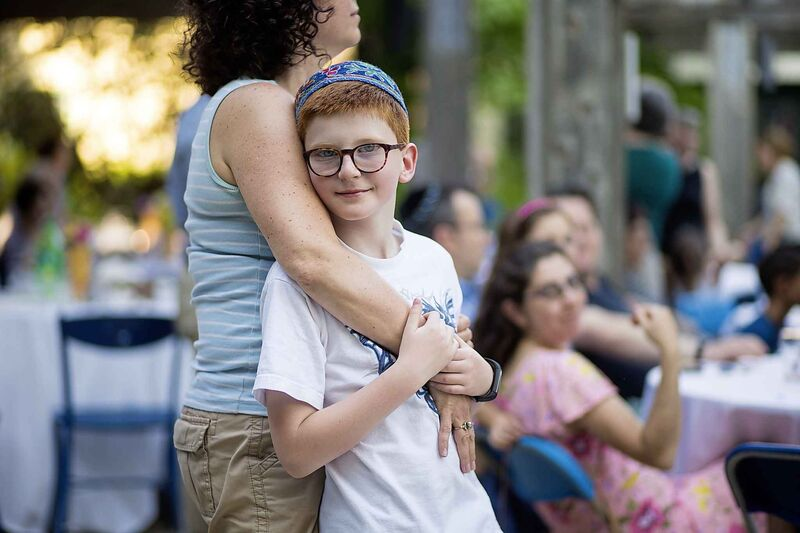 Yaron Skladnik, eight, dances with his mom, Dafne Orbach.