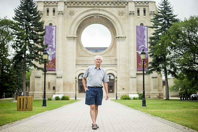 Phil Mailhot, former director of the St. Boniface Museum, poses in front of the St. Boniface Cathedral ruins in Winnipeg. (Mikaela MacKenzie / Winnipeg Free Press files)