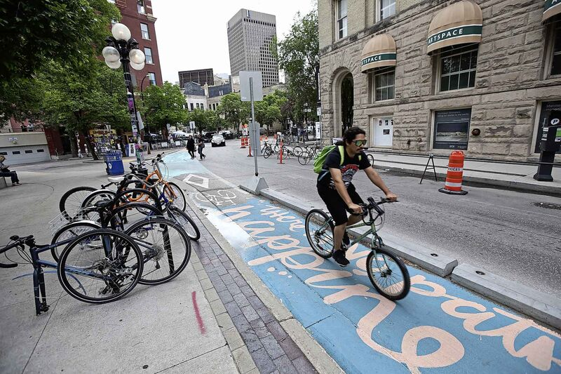 Cyclists in the Exchange District Tuesday morning.  (Mike Deal / Winnipeg Free Press)