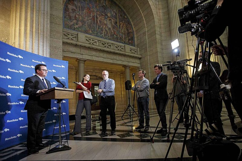Municipal Relations Minister Jeff Wharton speaks to reporters on Wednesday.