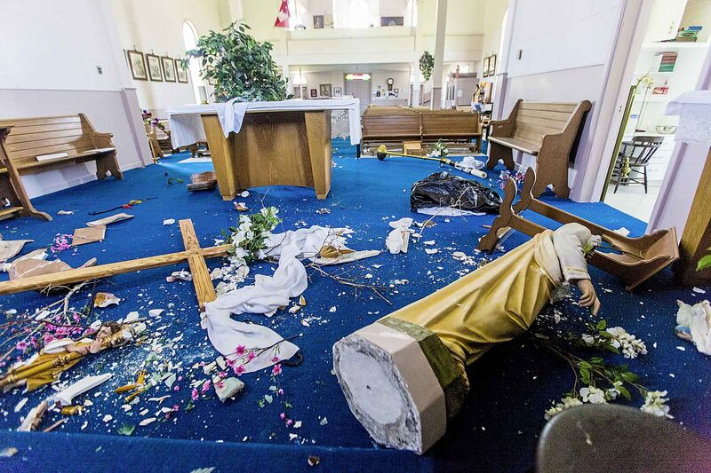The vandalized altar at St. Francois Xavier Catholic Church.