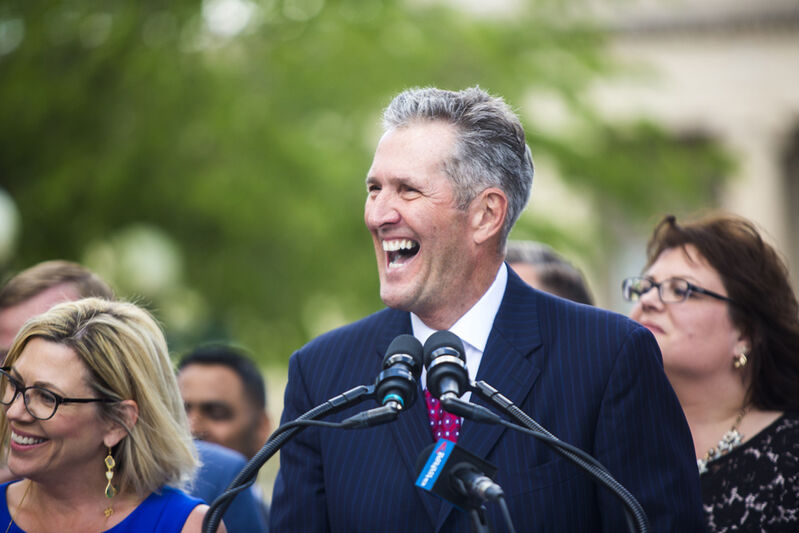 Premier Brian Pallister announces a September election date in front of the Manitoba Legislative Building with his cabinet last week.