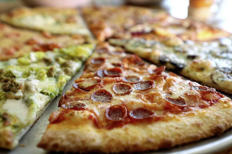 Crust is crucial for New York pizza, and at Wall Street Slice it's perfect. (Ruth Bonneville / Winnipeg Free Press)