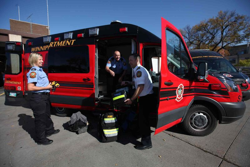 Winnipeg Fire Paramedic Service Deputy Chief Tom Wallace (right) unveils one of the 'squad' vans in the fall. WFPS utilizes three of the smaller vehicles, each of which handles roughly 6,000 calls a year.
