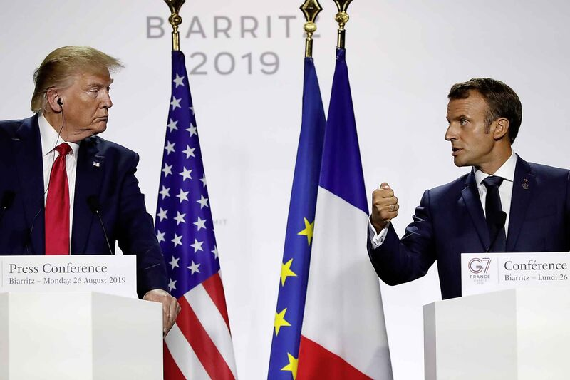 French President Emmanuel Macron (right) and U.S President Donald Trump attend the final press conference during the G7 summit Monday.  (Francois Mori / The Associated Press)