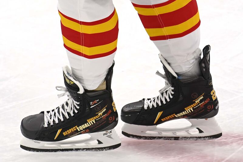 Calgary Flames defenceman Oliver Kylington wears special skates as a tribute to former NHL player Willie O'Ree as part of Black History Month during warm-up on Wednesday.