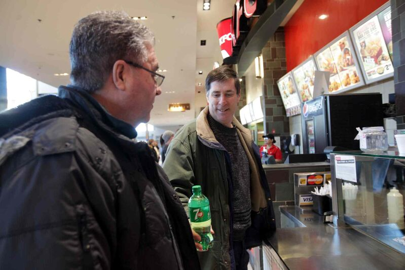 Doug and his support worker Howard Andersen spending time together at the mall before heading to a movie. Their outings help keep Doug active and socially connected.  (Ruth Bonneville / Winnipeg Free Press)