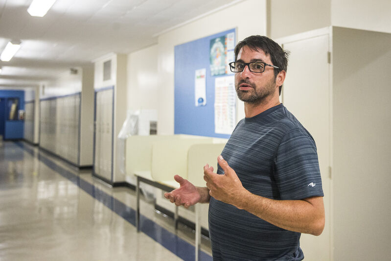 Shaun Bright, vice-principal of summer session, gives a tour of  Andrew Mynarski School in Winnipeg on Thursday.