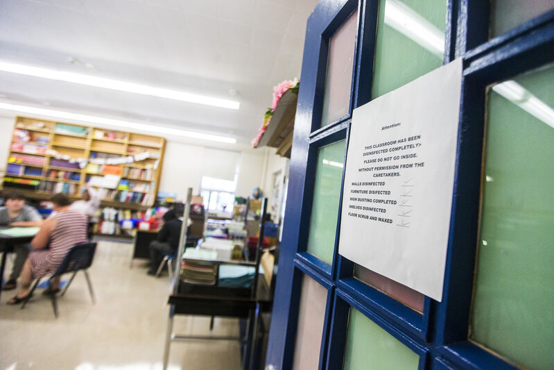 Classroom doors remain open throughout the day to minimize the need to touch surfaces.