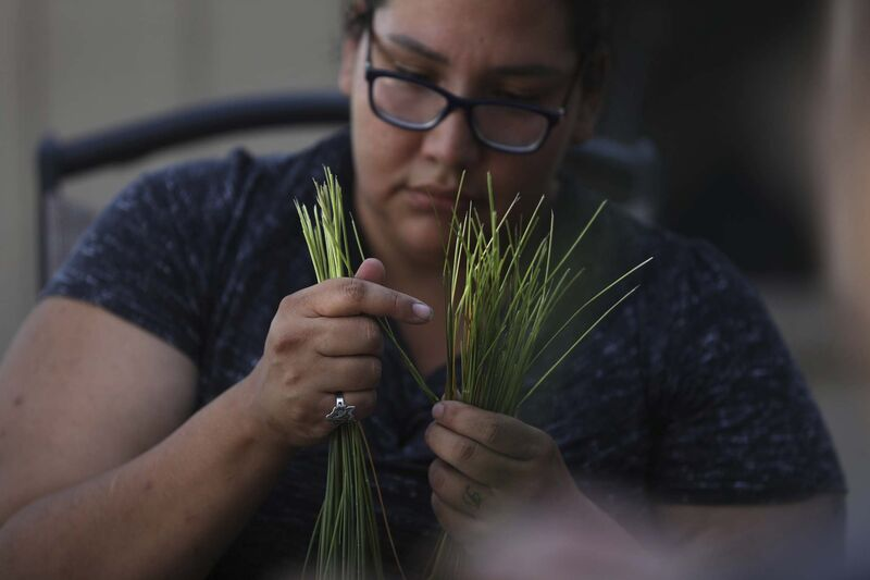 Adriana Brydon braids sweetgrass from the garden.