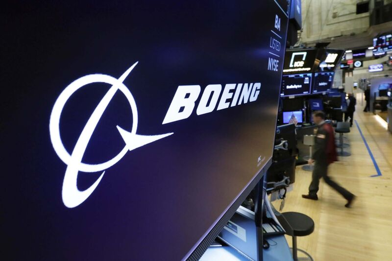 The Boeing logo appears above a trading post on the floor of the New York Stock Exchange. Shares in the aircraft maker fell Tuesday amid safety concerns following another deadly crash involving its most popular plane. (Richard Drew / The Associated Press)</p>