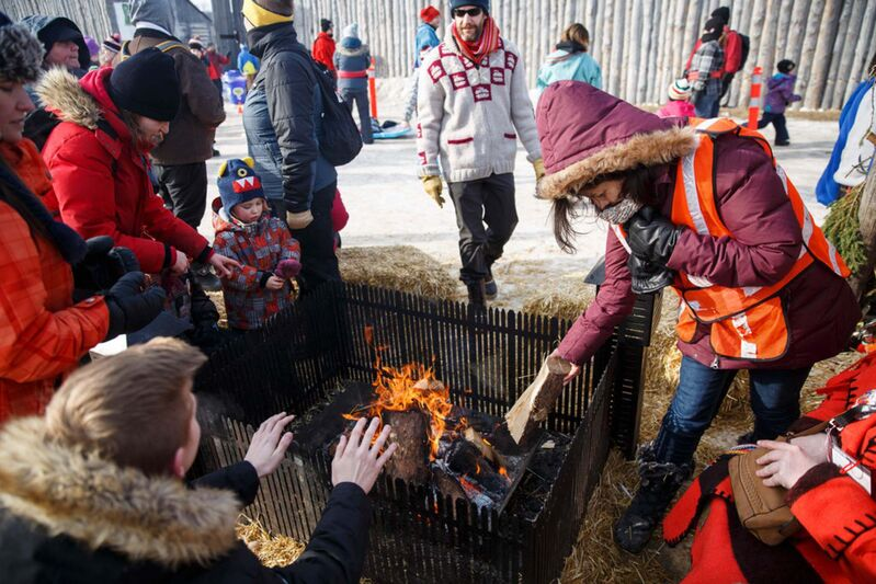The communal fires scattered throughout Whittier Park and Fort Gibraltar during Festival du Voyageur always manage to draw a crowd. (Winnipeg Free Press files)