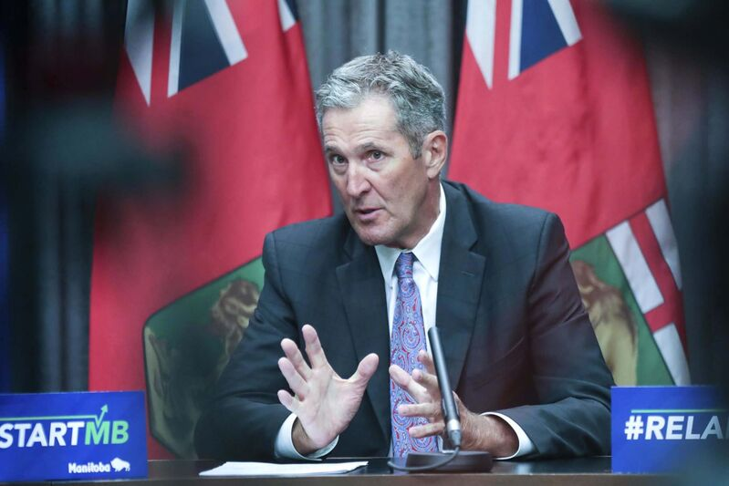 """Premier Brian Pallister was in Brandon to announce the newly launched public-relations campaign and the provincial government's new pandemic-reopening slogan — """"Ready. Safe. Grow. #RestartMB"""". (Ruth Bonneville / Winnipeg Free Press files)"""