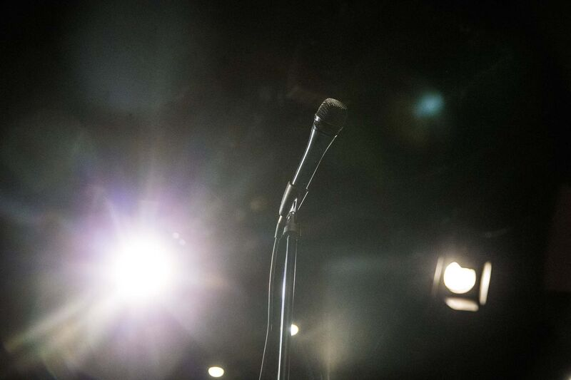 Comedy clubs typically have the performer use a microphone, so they're not yelling.