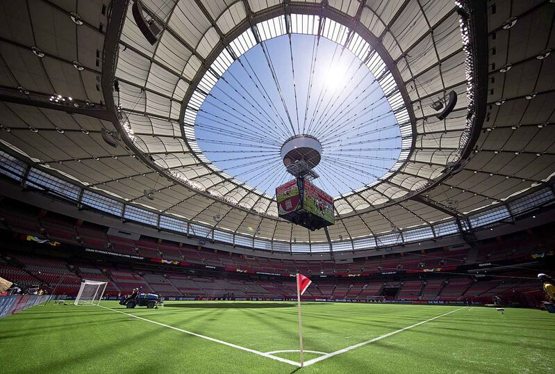 Water is sprayed on the artificial turf before Switzerland and Ecuador play a FIFA Women's World Cup soccer match at B.C. Place stadium in Vancouver, B.C., on June 12, 2015. (Darryl Dyck / The Canadian Press files)