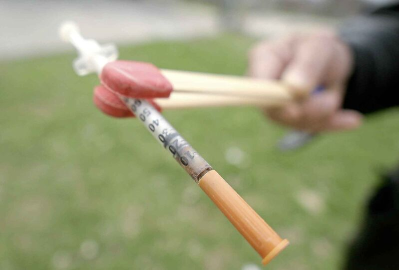 A discarded needs, like hundreds volunteers have found in city parks. (Mike Aporius / Winnipeg Free Press)