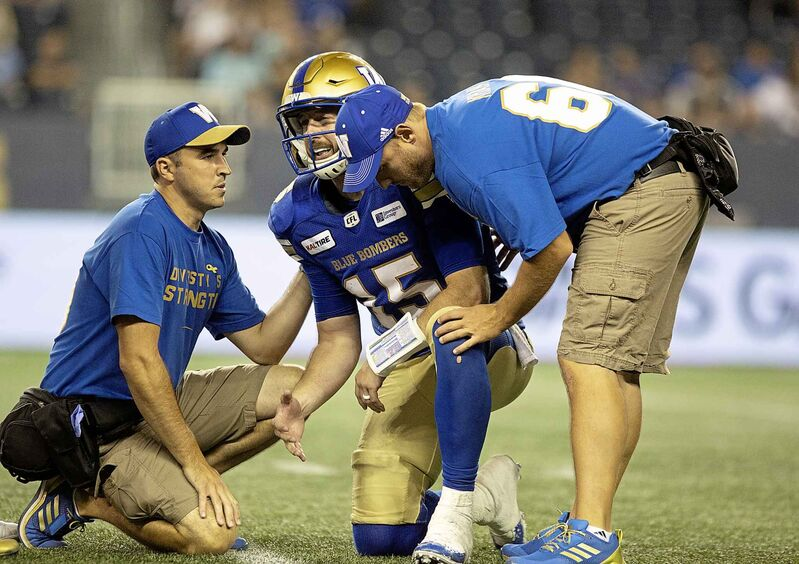 Nichols is helped off the field after being injured in a game against the Ottawa Redblacks at Investors Group Field on August 17.
