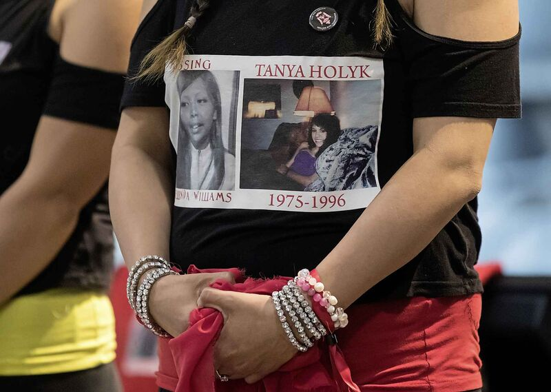 Lorelei Williams, whose cousin Tanya Holyk was murdered by serial killer Robert Pickton, and whose aunt Belinda Williams went missing in 1978, wears a shirt bearing their photographs at the release of the report on the National Inquiry into Missing and Murdered Indigenous Women and Girls. (Darryl Dyck / The Canadian Press files)