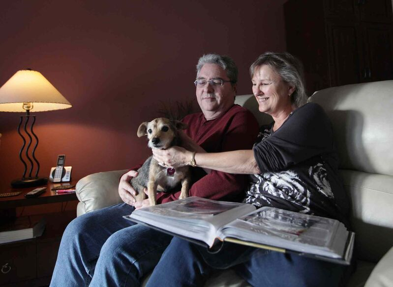 Doug and Sandy share a happy moment on the couch at home with their dog Ruby.  (Ruth Bonneville / Winnipeg Free Press)