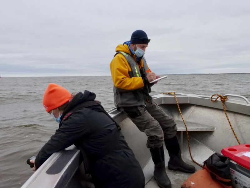 Jillian St. George and Stephen Petersen document a water reading at the mouth of the Churchill River.