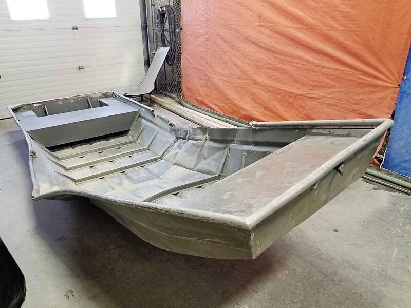 A damaged aluminum boat found by Manitoba RCMP officers on the shores of the Nelson River during a helicopter search on August 2. (RCMP handout)