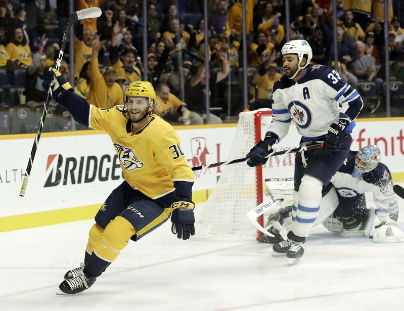 <p>Nashville Predators right wing Ryan Hartman celebrates after scoring a goal against Winnipeg Jets goaltender Connor Hellebuyck during the second period Thursday, in Nashville.</p>