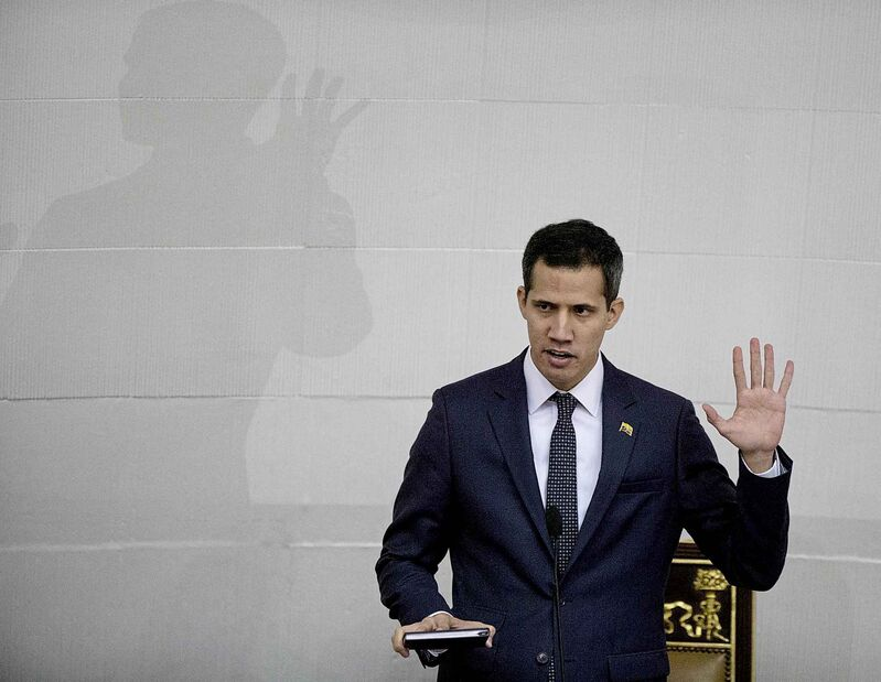 Venezuelan lawmaker Juan Guaido takes the oath of office as president of the National Assembly in Caracas, Venezuela.