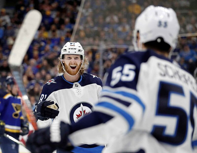 Winnipeg Jets' Kyle Connor, left, is congratulated by Mark Scheifele after scoring during Game 3 against the St. Louis Blues in the Jets 6-3 win. Scheifele is currently the third-highest paid Jet behind Dustin Byfuglien  and Connor Hellebuyck but that's about to change with Connor and Patrik Laine both due big pay raises this summer.