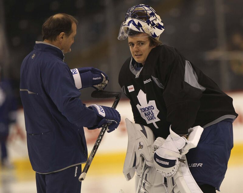St. Croix chats with goaltender Ben Scrivens during practice in 2013 (Joe Bryksa / Free Press files)